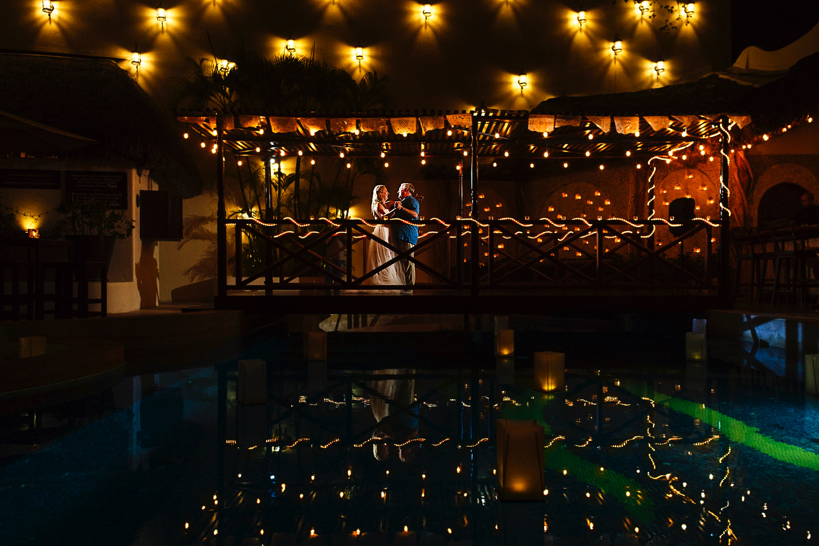 bride-father-dance-hotel-playa-fiesta-dancefloor-pool-candles-lights.jpg