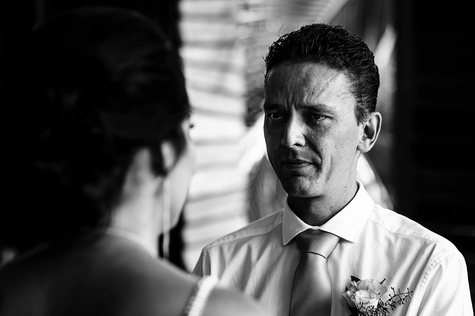 Groom tearful at the wedding ceremony during vows.