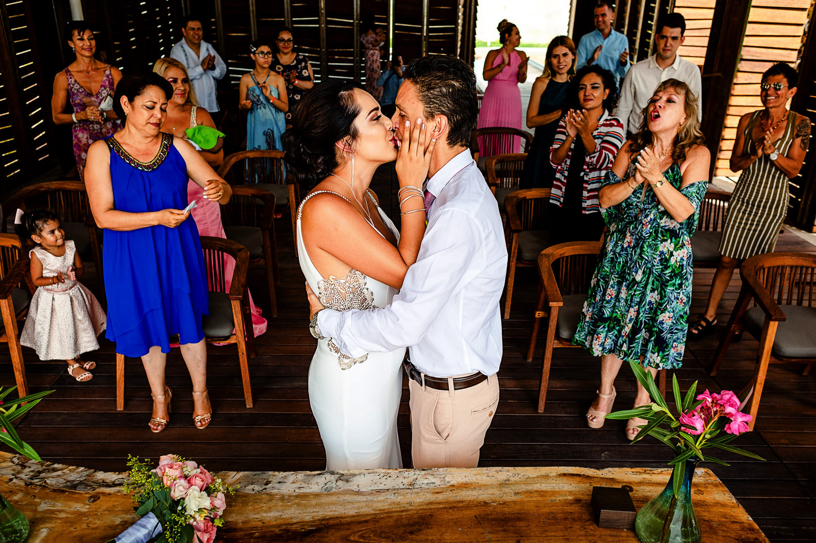 Bride and groom first kiss at the end of their wedding ceremony at La Patrona beach club in San Pancho, Nayarit.
