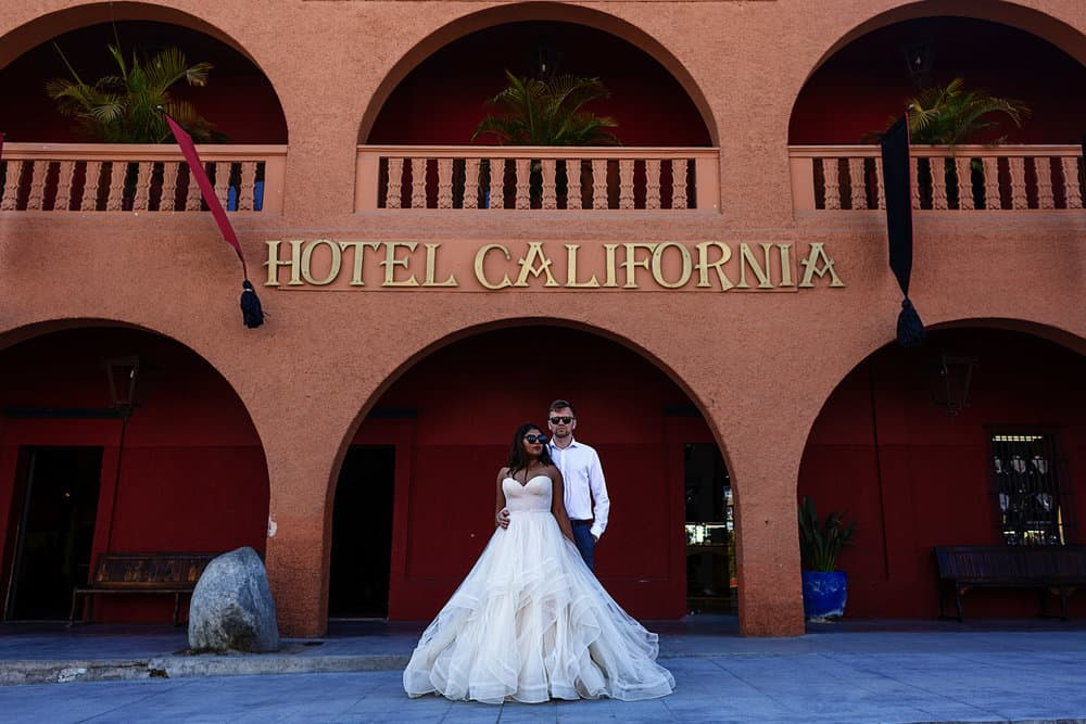 Bride and groom standing outside the world famous Hotel California in Todos Santos.