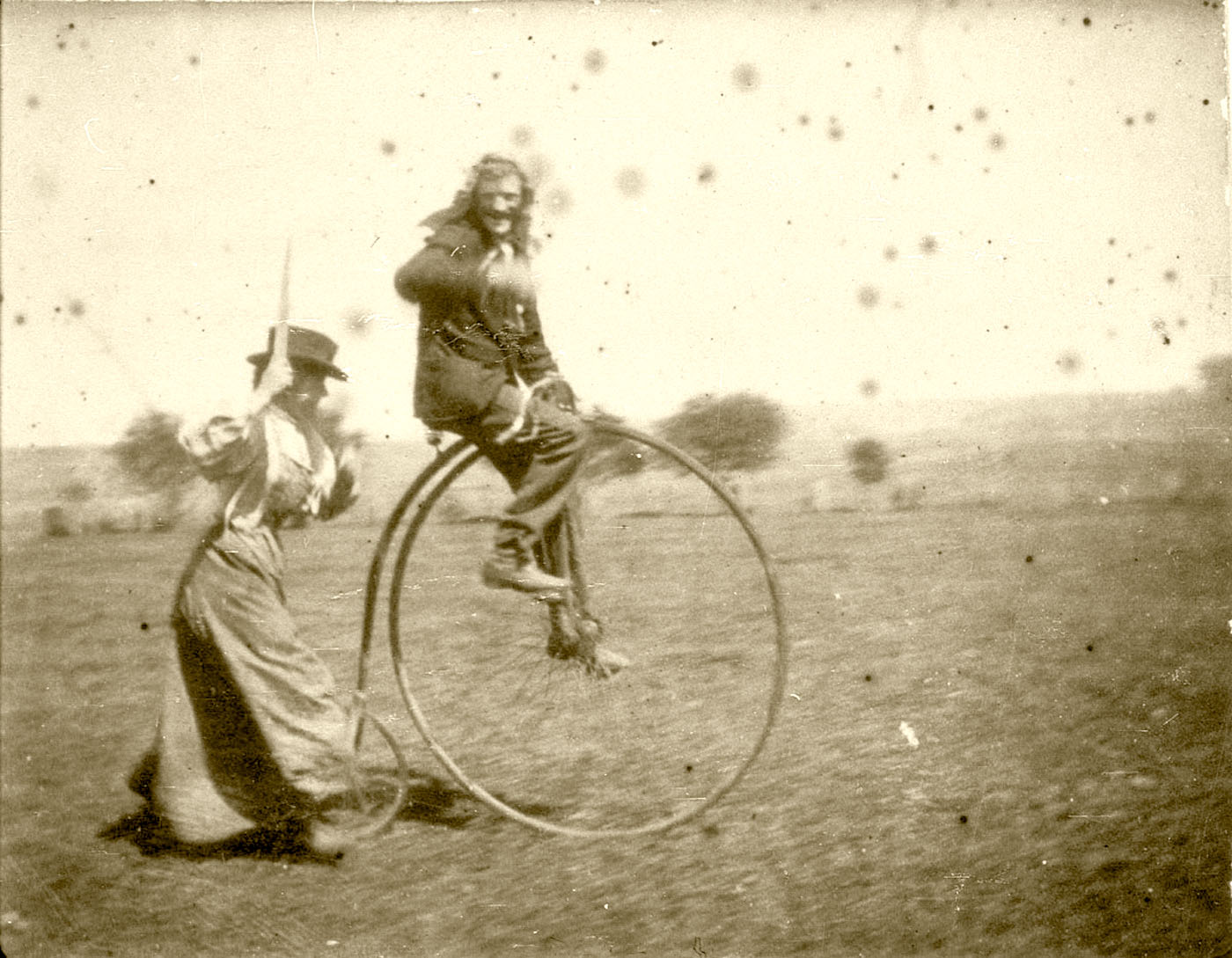 Bob Spiers on a Penny Farthing being chased by his sister Maggie, West Wyalong NSW. Image used courtesy of the Collection of the State Library of NSW