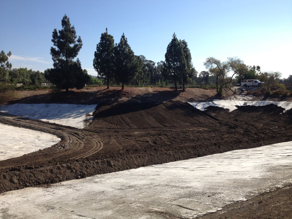 After the sealant dried, a cover of native soil was spread and compacted to protect the waterproof layer. Then the pond was filled successfully.
