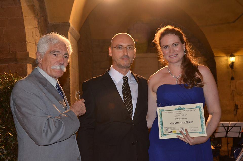 Charlotte-Anne receiving her Third Prize certificate from Maestro Antonio Bellandi and Maestro Egidio Saracino