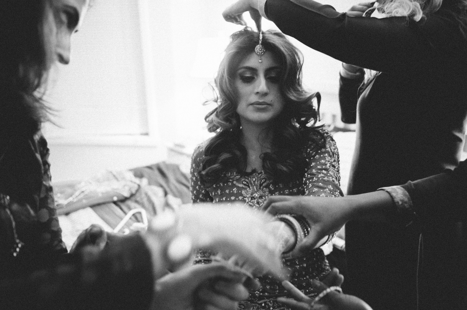 Black and white image of Pakistani bride preparations