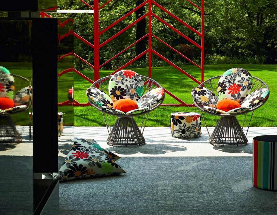 "The ""Cordula"" chairs with Margherite Outdoor fabrics, cushions and poufs."