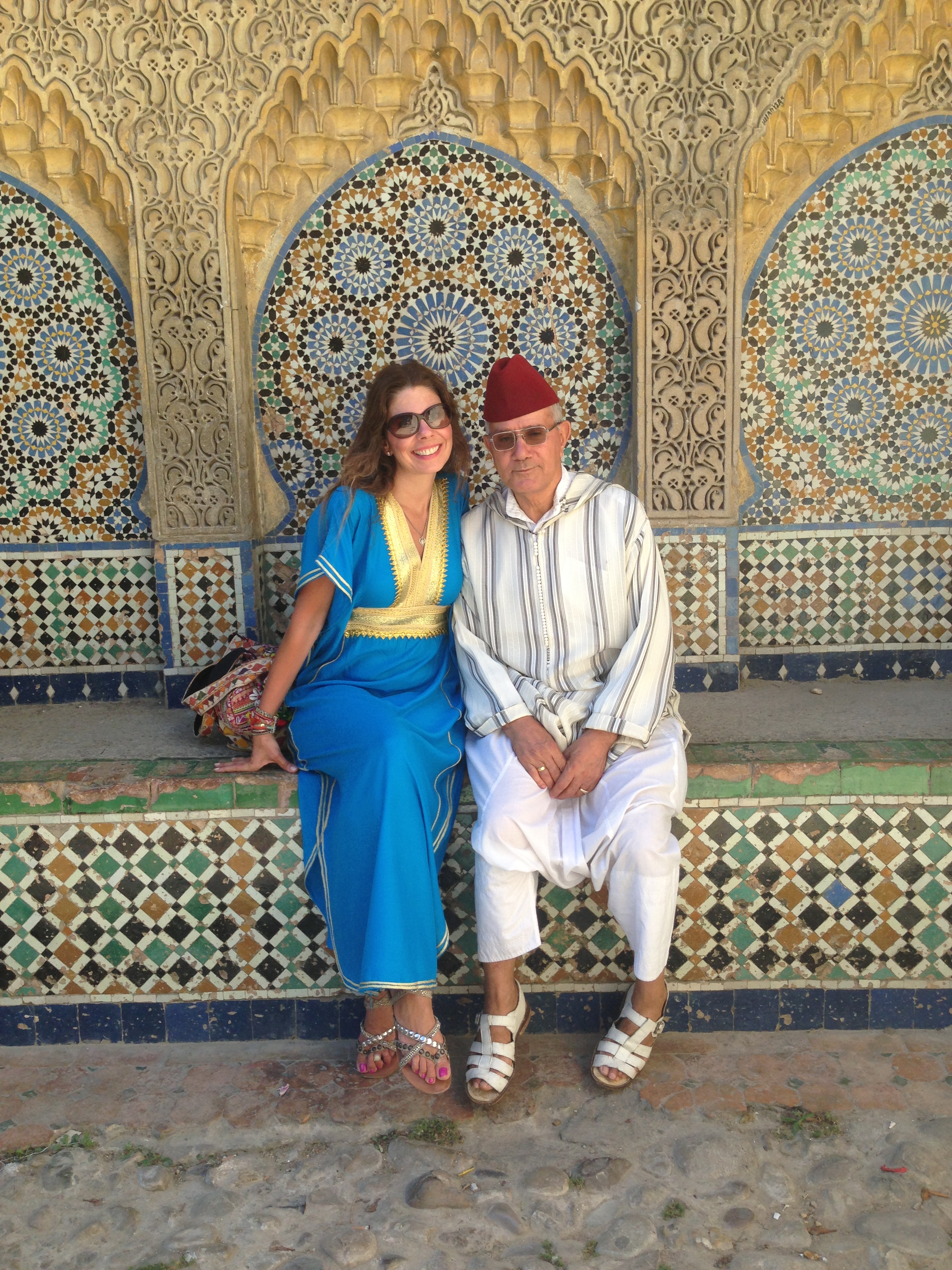 Me and our amazing guide, Tifo, taking a break in the Kasbah.