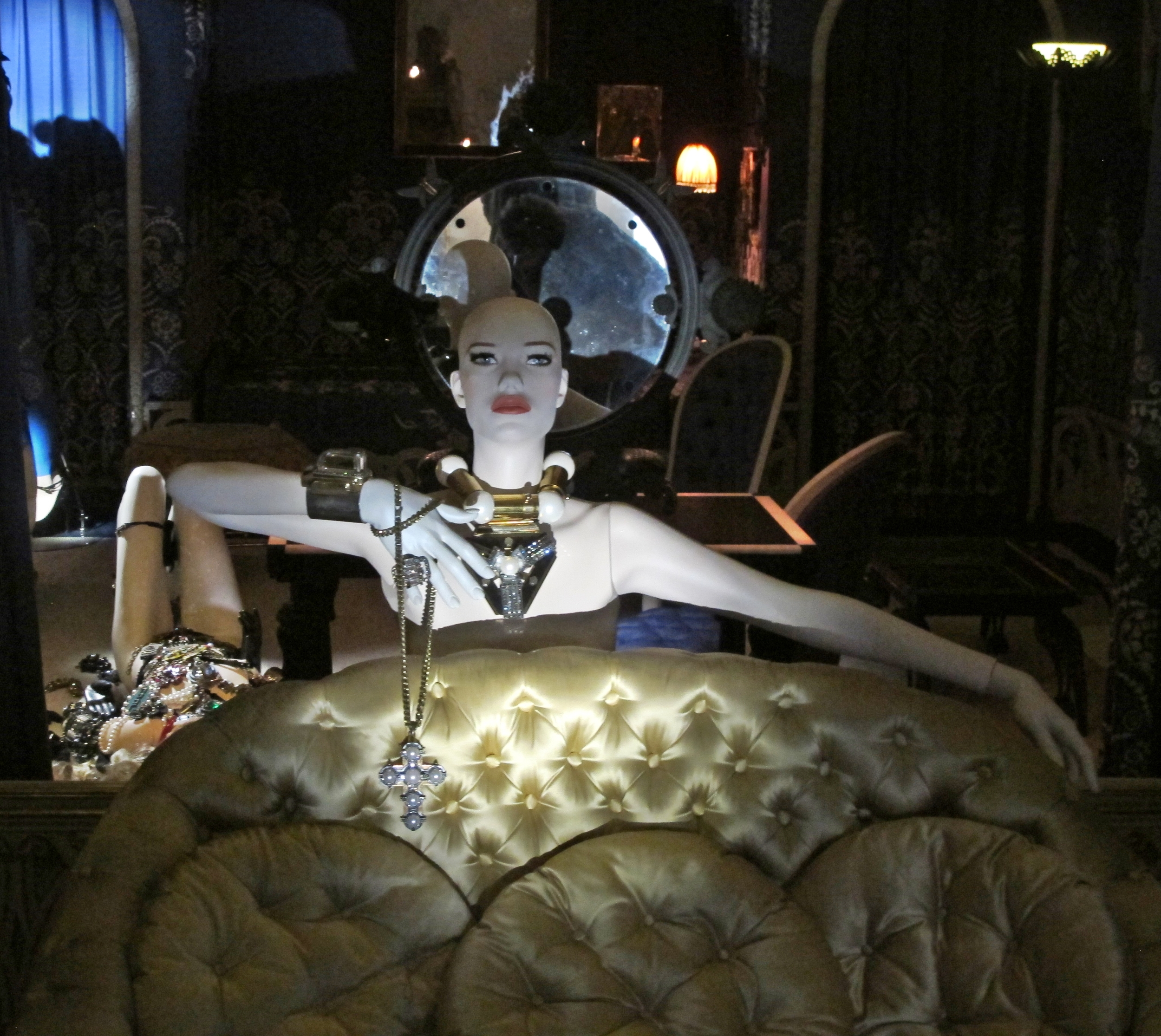 The brand new collection of Lanvin's jewelry is shown here next to a 1920s loveseat designed by Armand-Albert Rateau