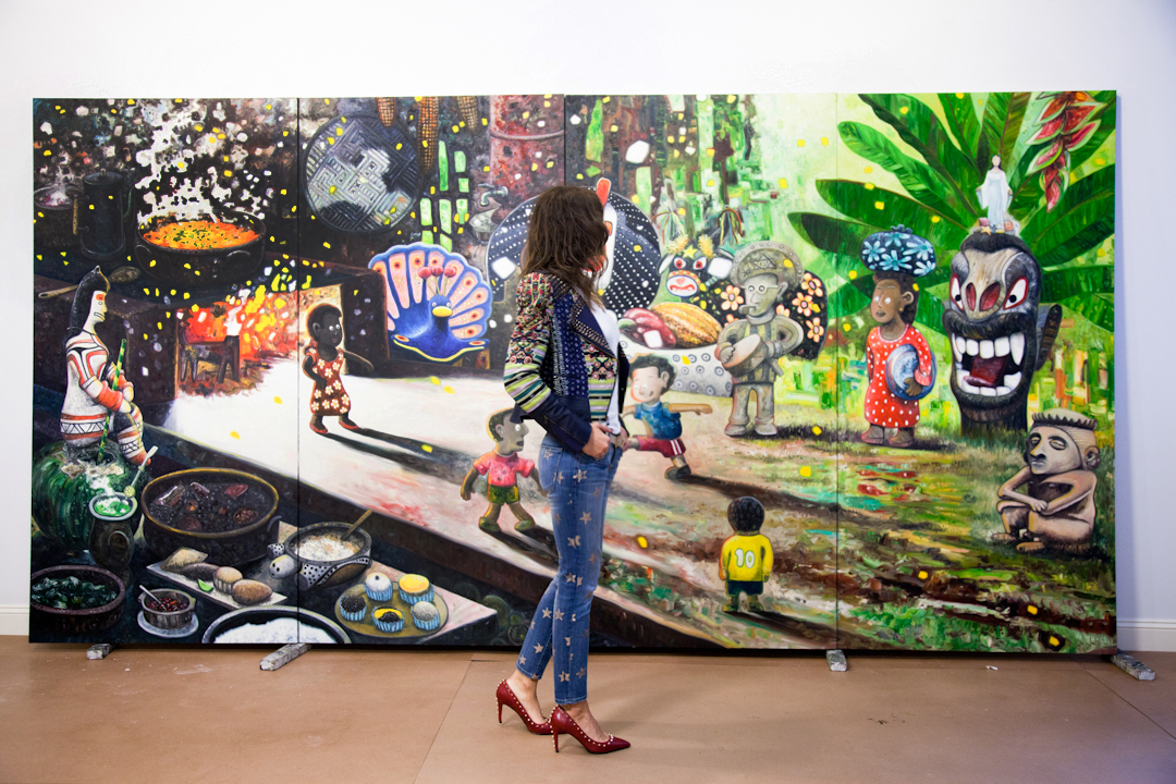 With my favorite piece in Oscar's studio: a four-canvas magic realism composition depicting cultural Brazilian elements, some old, some new. Photos by Lianna Tarantin