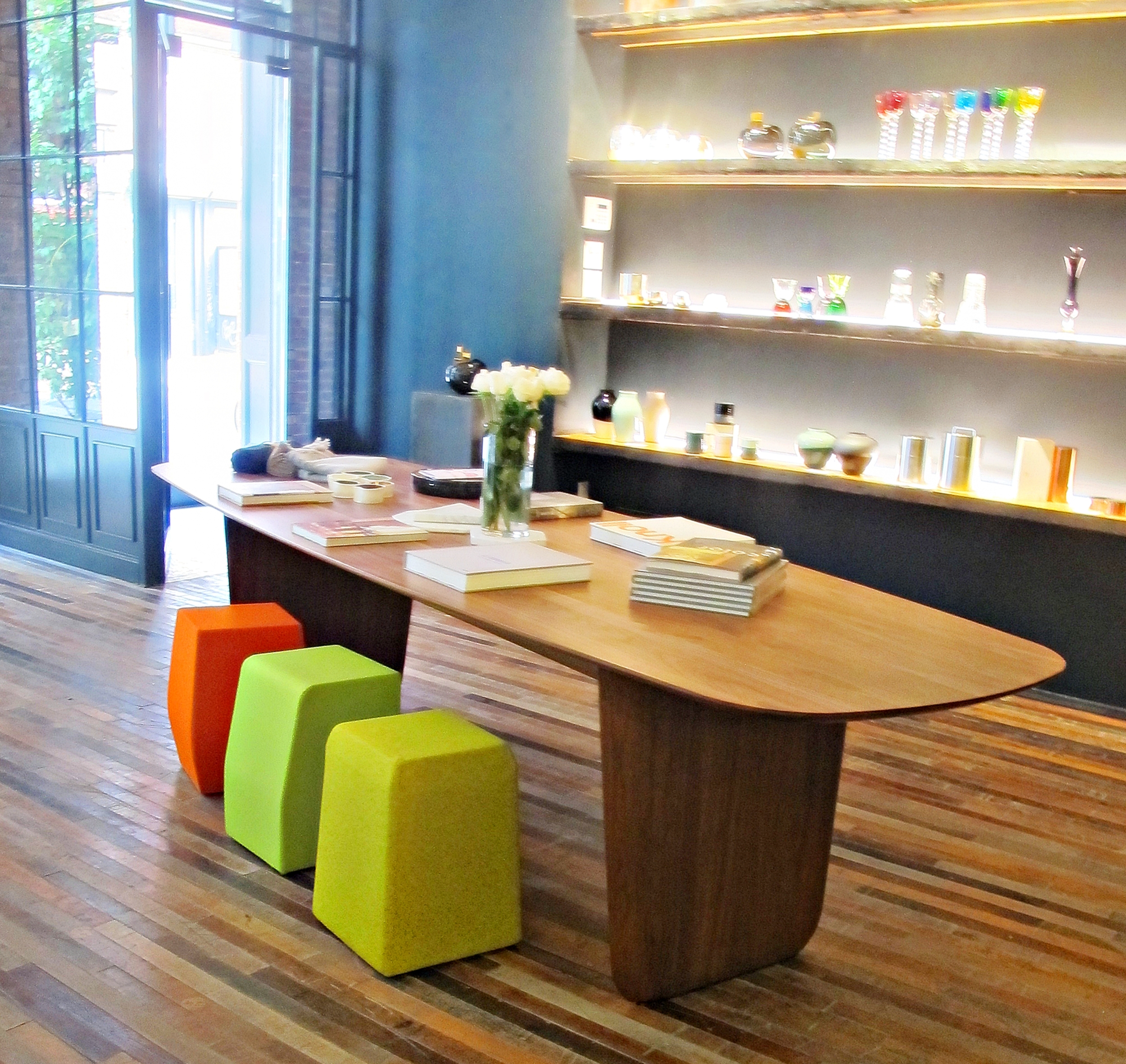 The gorgeous solid oak table and the colored stools are by Eric Jourdan for Domeau & Pérès.