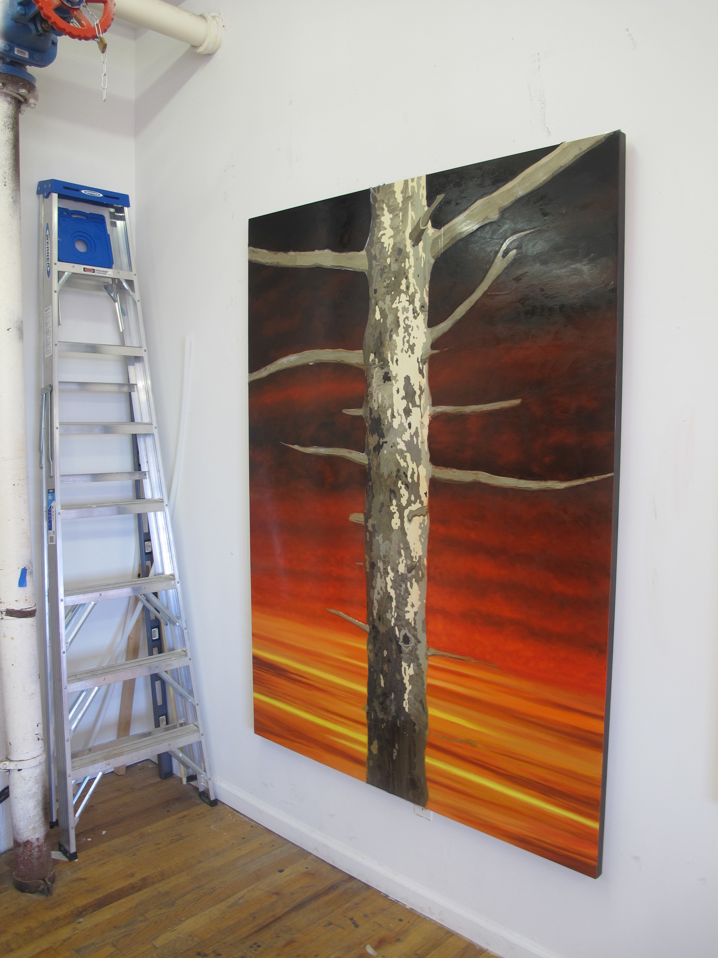 """This is the final piece in Ali's studio, which she first conceived in the digital image above: a wood panel that has been transformed with oil, wood veneer and shellac and which is called """"Sebastian II""""."""