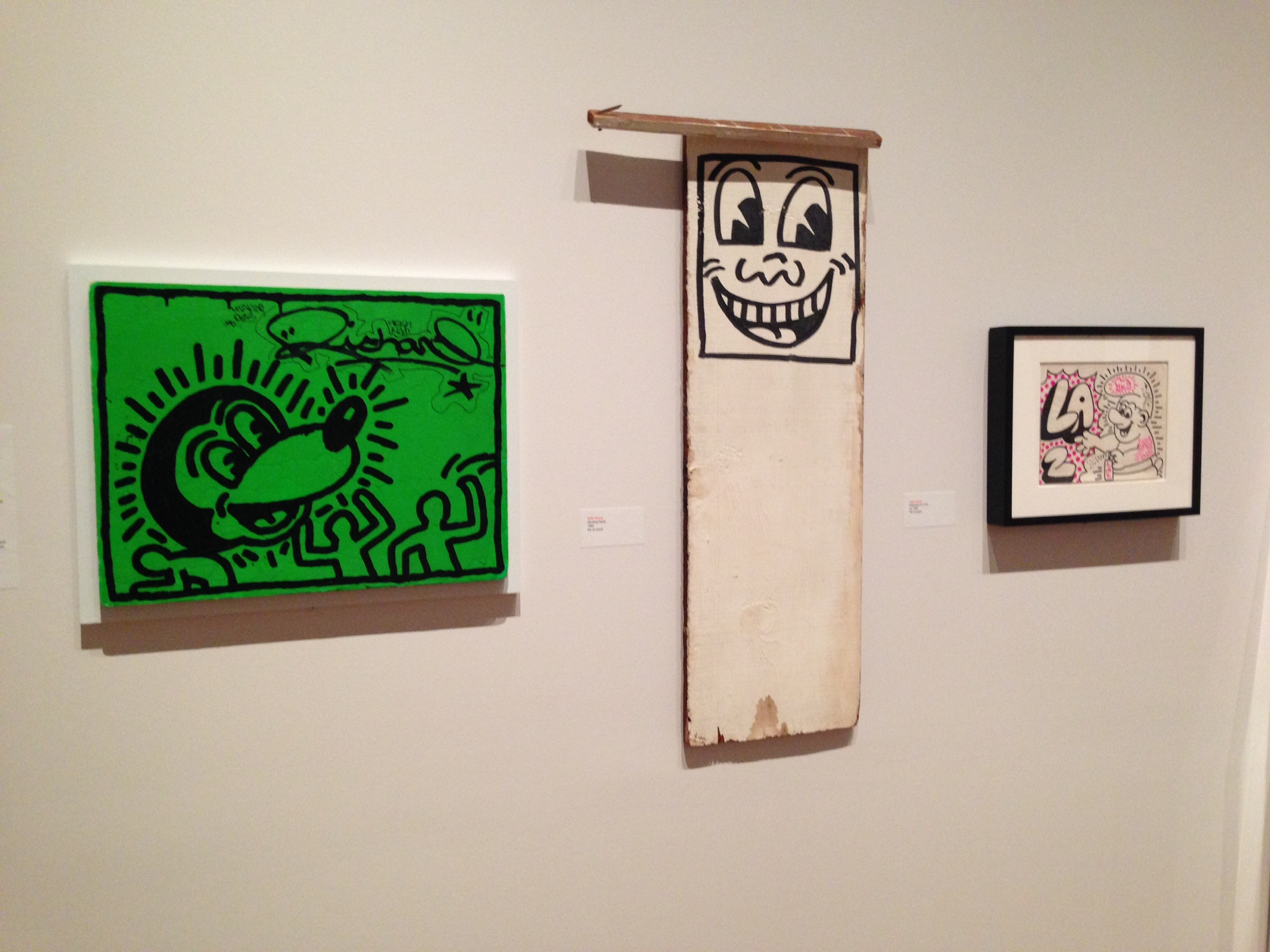 Three of the Keith Haring pieces in Wong's collection. It's so cool to see artworks like these that still feel so gritty and so New York.