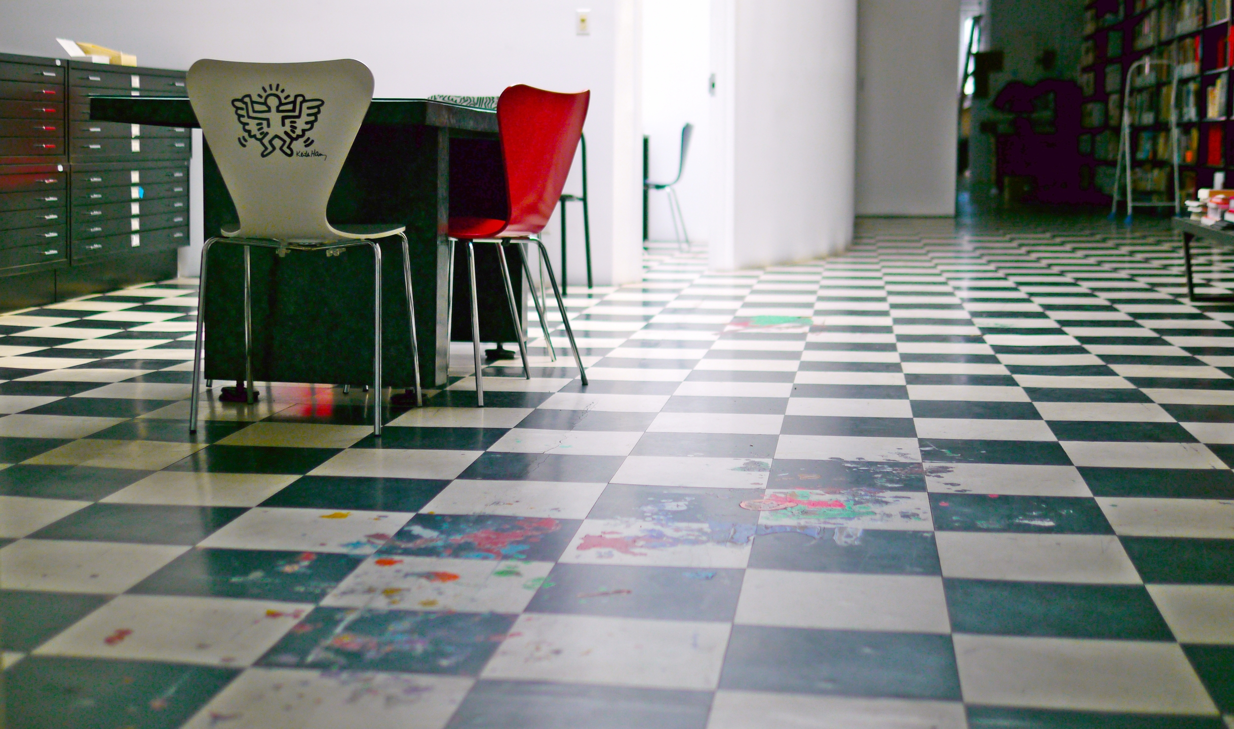 The splotchy marks of paint on the floor were left there by Keith when he used to paint in this studio. Keith Haring artwork © Keith Haring Foundation