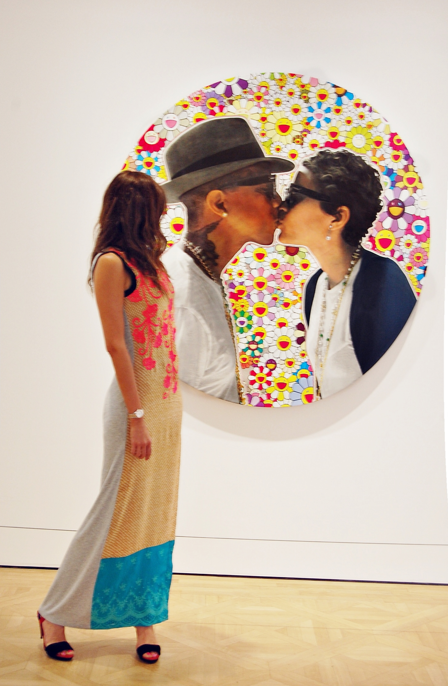 Another Takashi Murakami piece using Pharrel and Helen's portraits superimposed on top of his characteristic flowers.