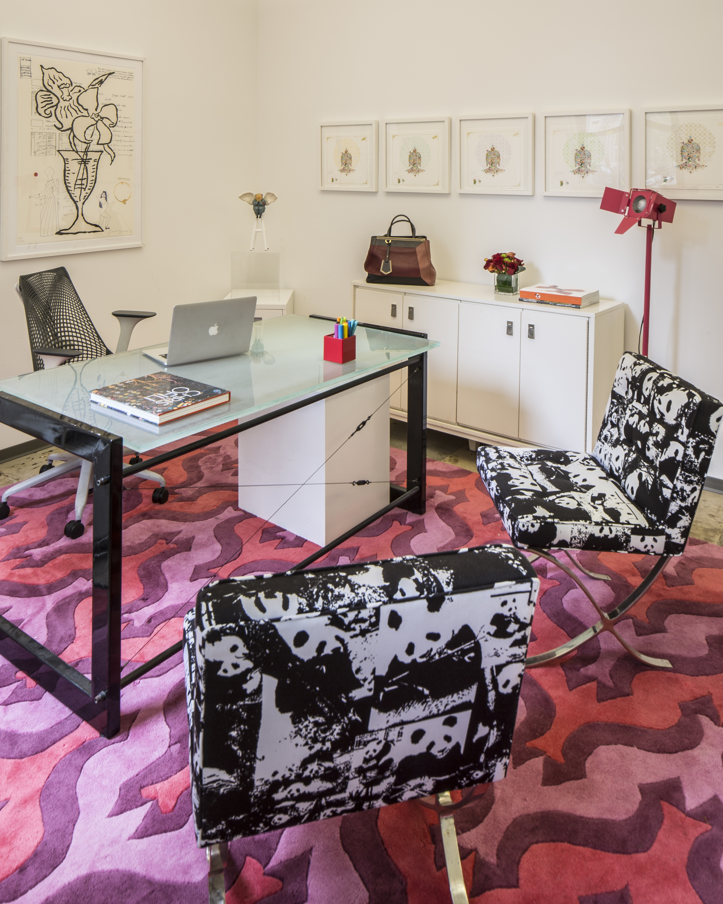 Catherine's office with pink and purple. I love that she isn't afraid of showing that she is a female executive. The chairs were reupholstered using Rob Pruitt's panda fabric.