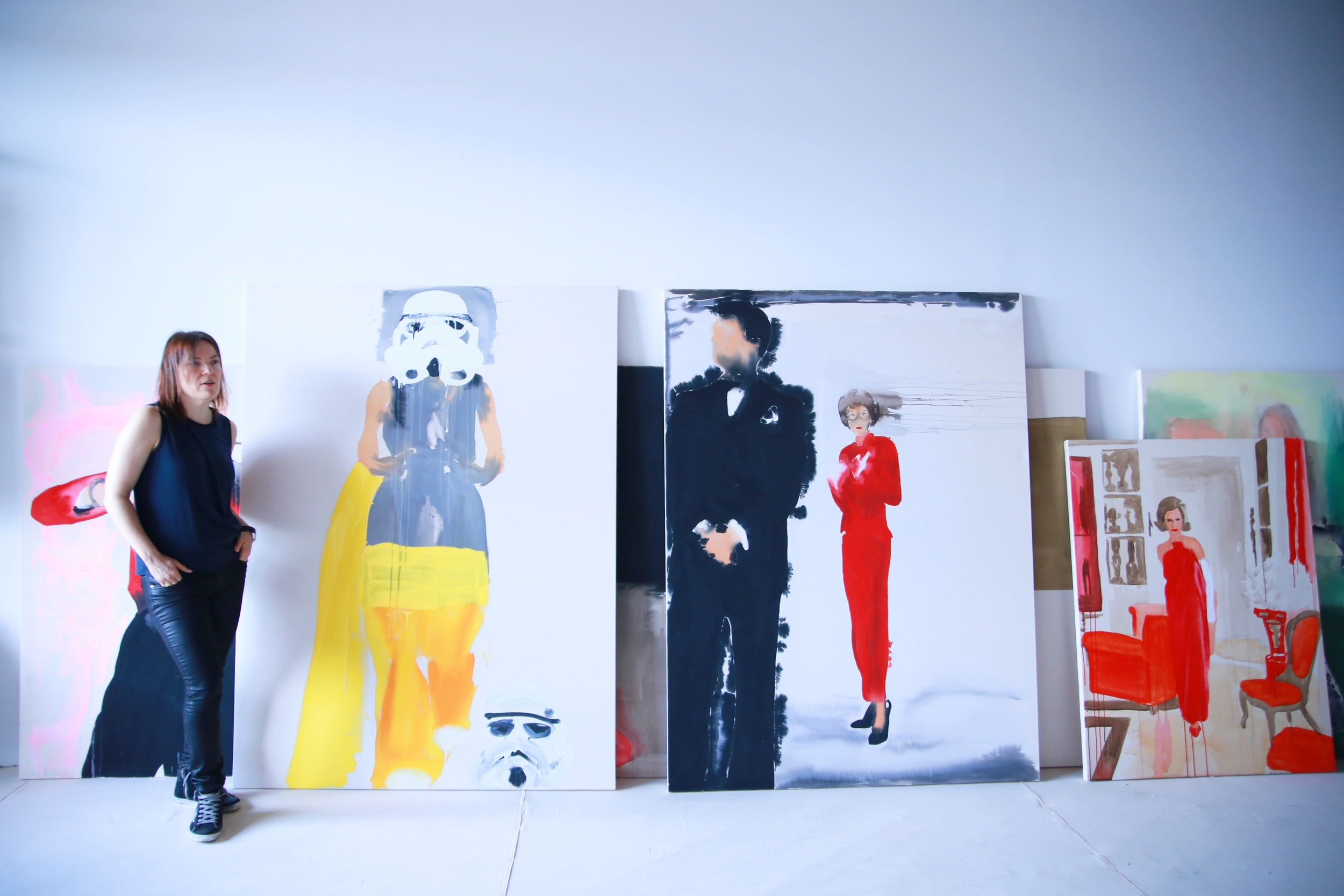 "Liz and her canvases: from left - ""Model 3""; ""Babe Paley 2"" and ""Lee Radziwill in Lanvin"""