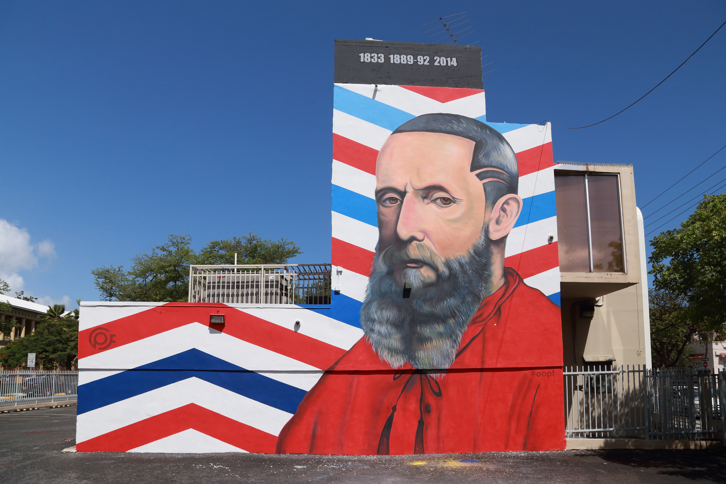 Omar Obdulio's mural shows a contemporary portrait of Francisco Oller, a famous Puerto Rican painter who died in 1917