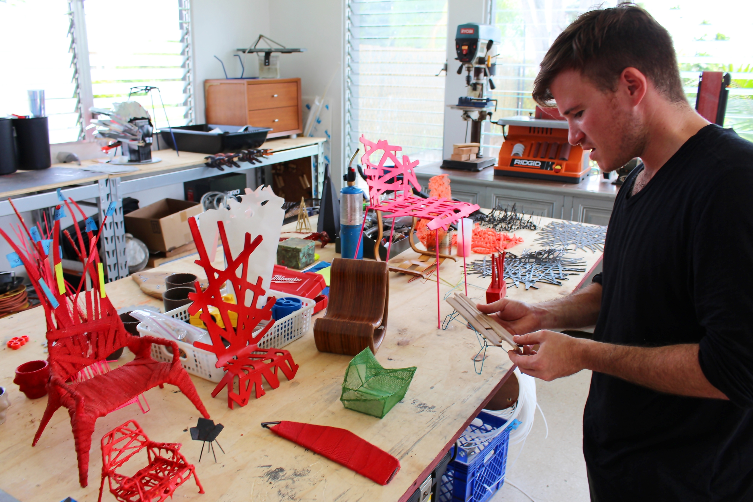 Victor Monserrate in his studio in Guaynabo with all his prototypes
