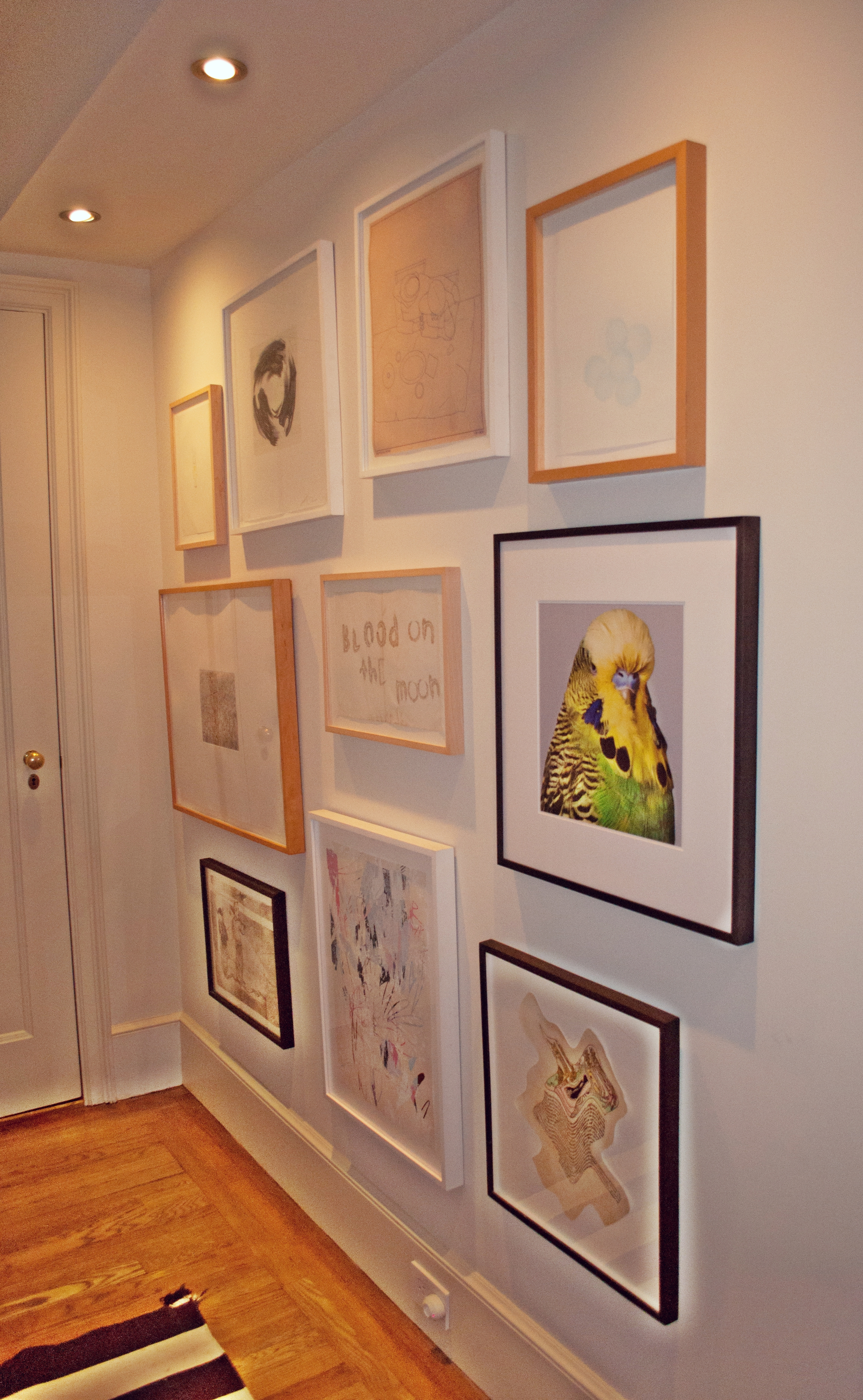 The entryway is filled with subtle works on paper hung in a gallery-style.