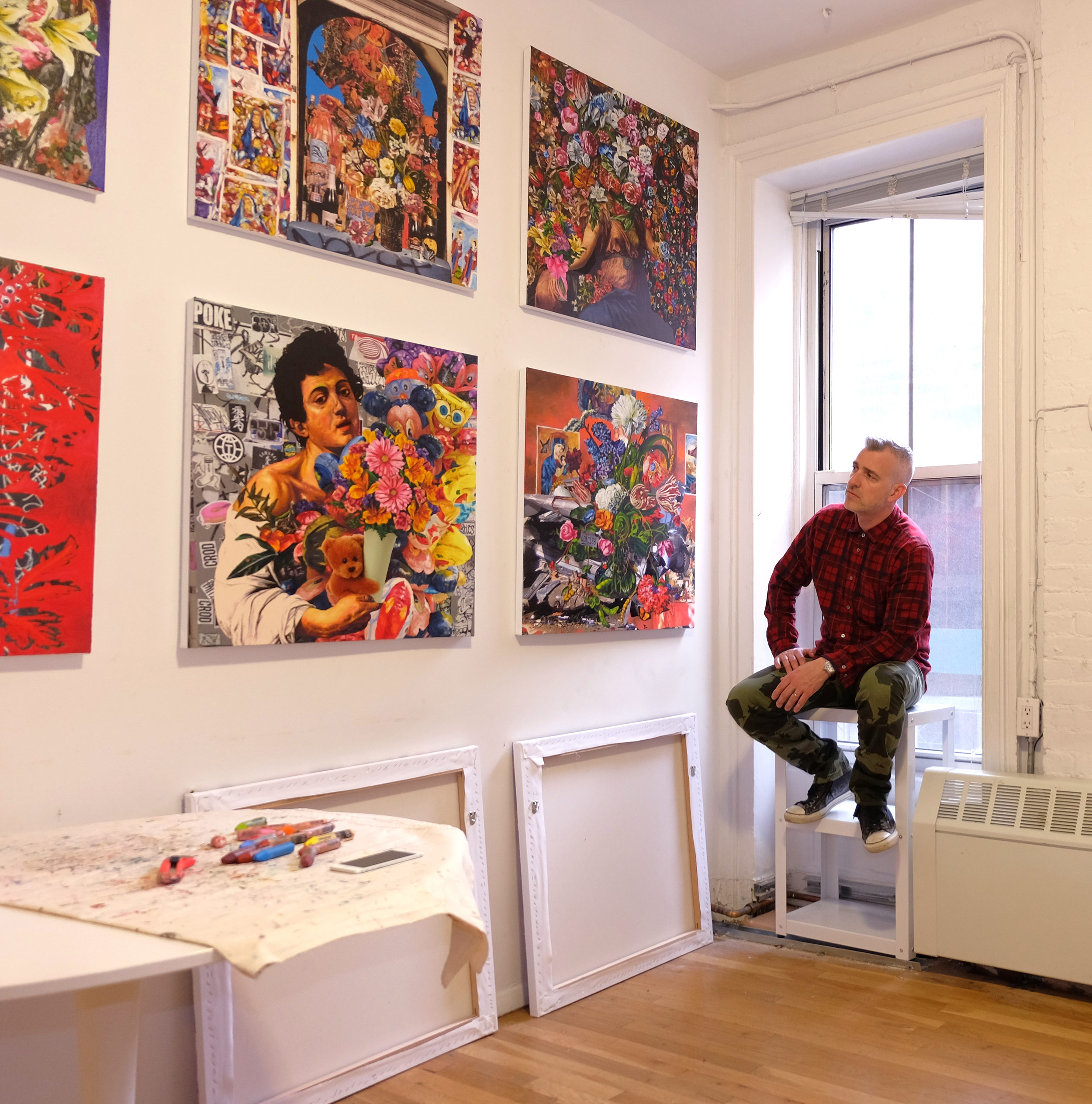 Michael Dayton Hermann in his Tribeca studio with some of the paintings in his upcoming solo show  Flowers.  Photo by James J Williams III.