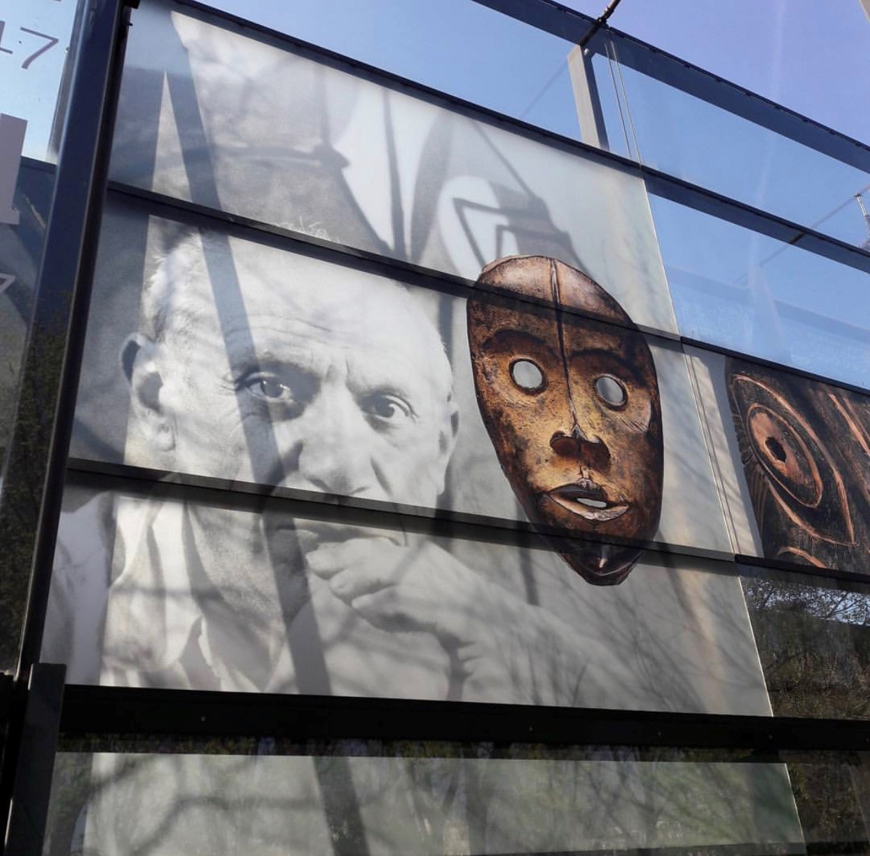 The external glass wall of the museum. Picasso's portrait is by Herbert List.
