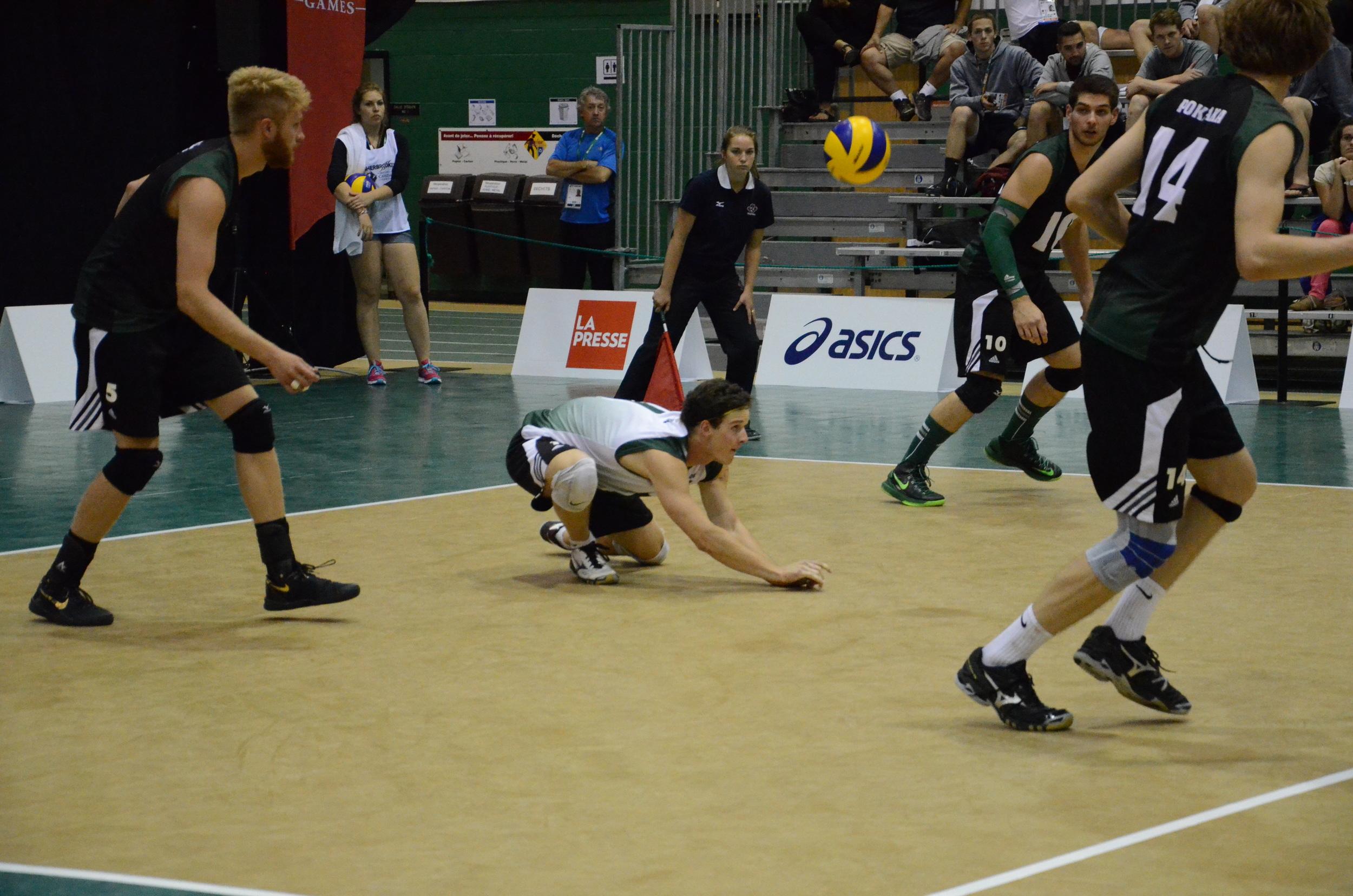 Team Saskatchewan receives a serve during a match at the Canada Games