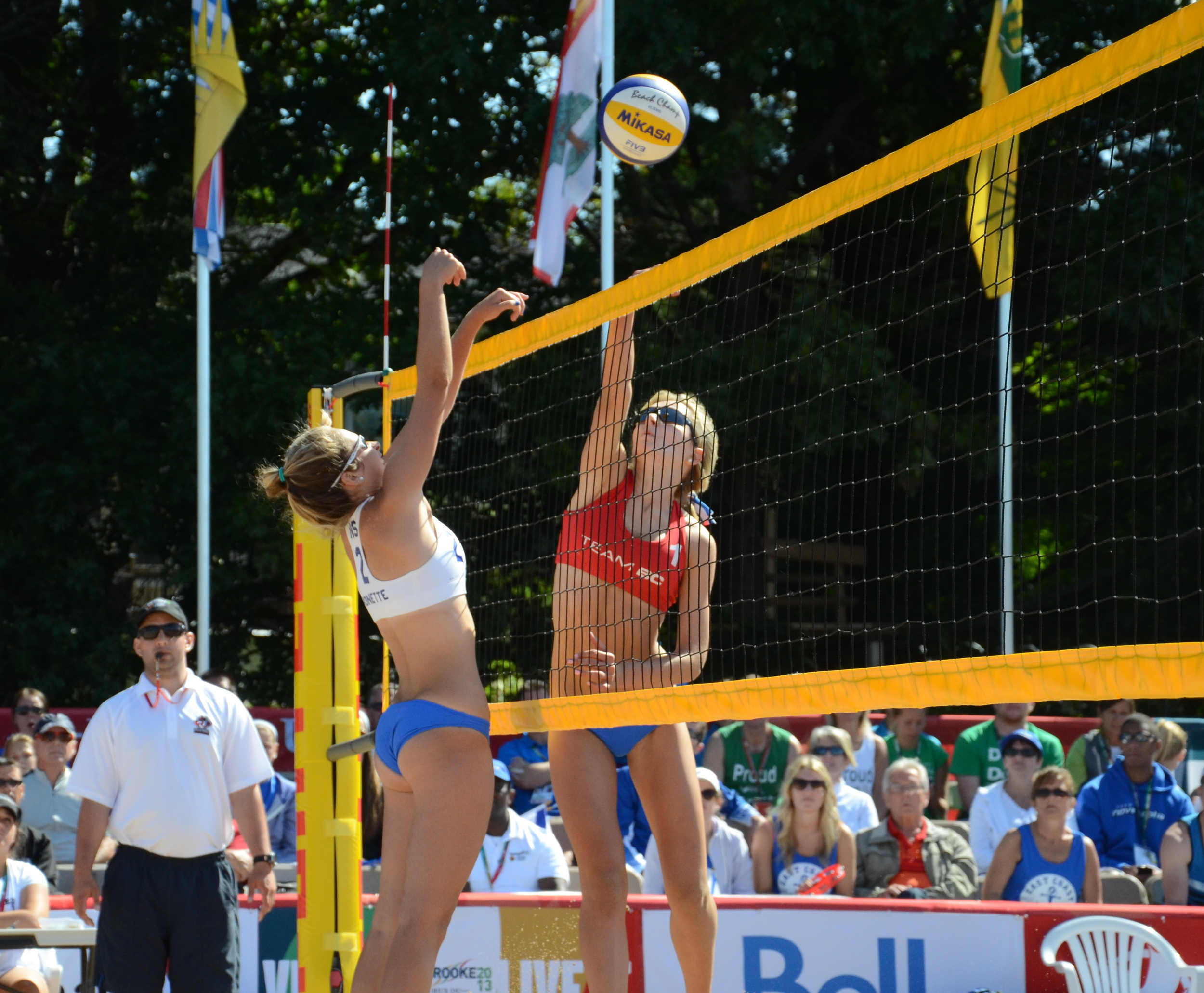 One of BC's McNamara twins battles at the net with Hillary Monette of Nova Scotia in quarterfinal play