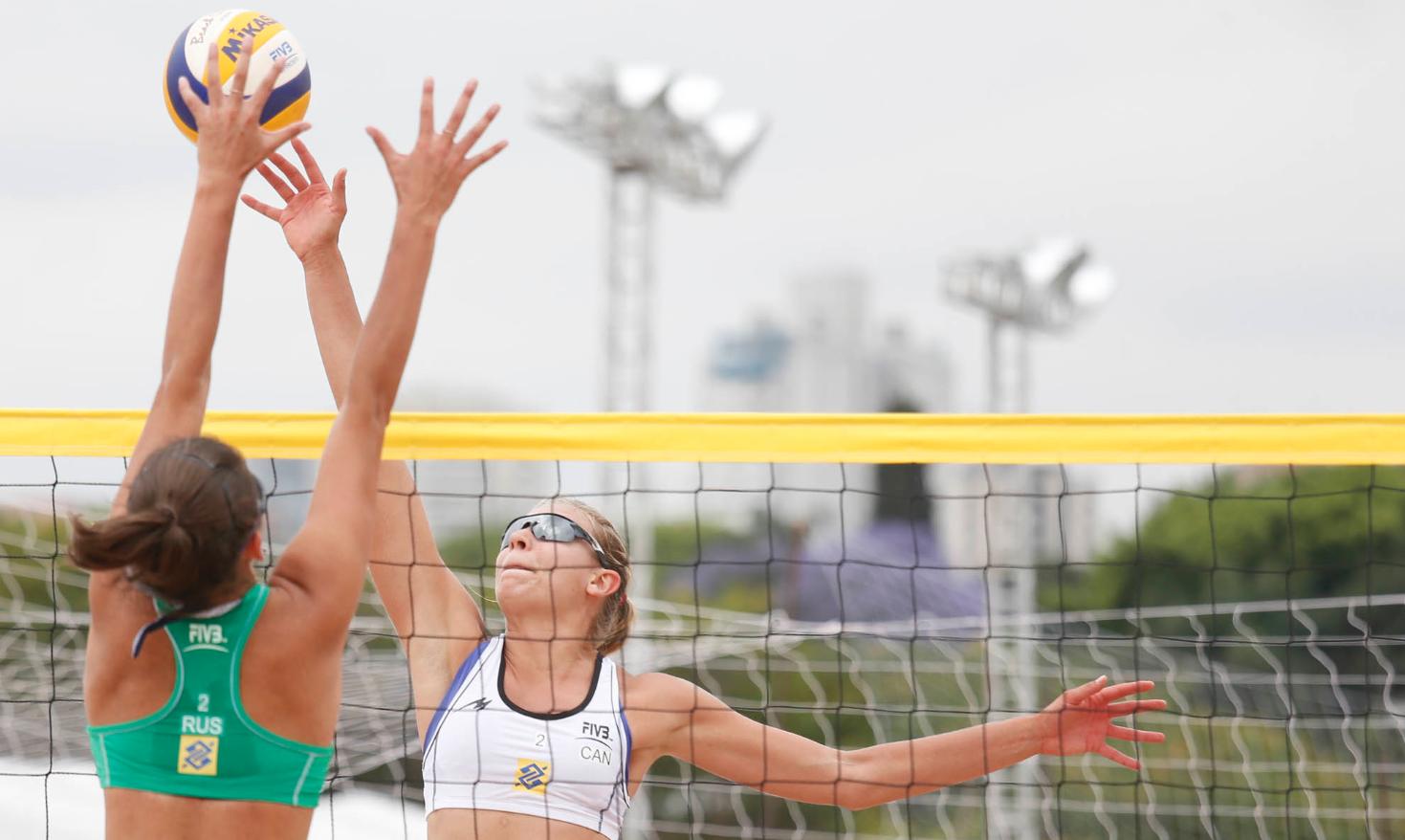Kristina Valjas wipes off the block in Sao Paulo. Photo: FIVB.