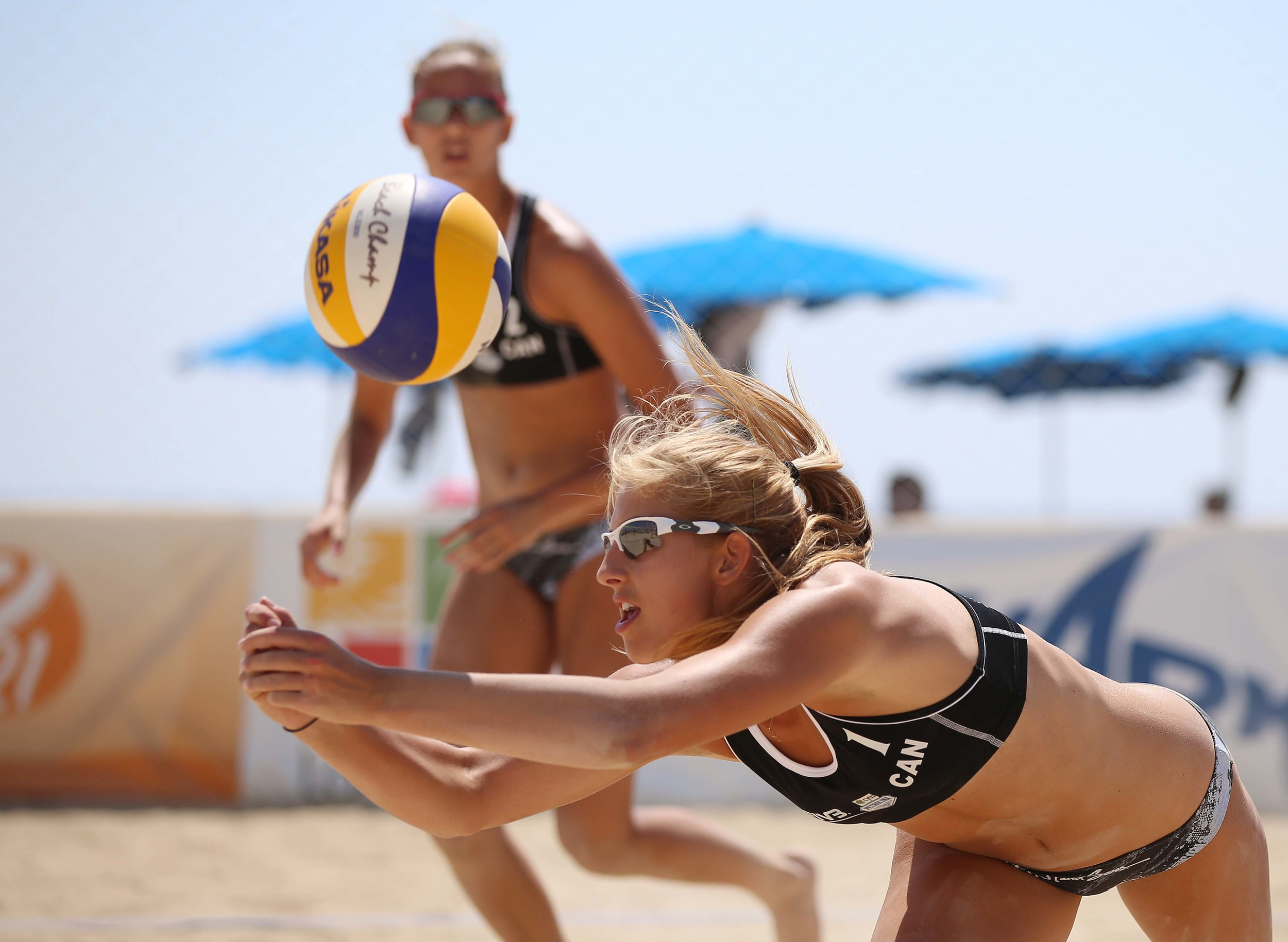 Tia Miric makes a dg while partnet Sophie Bukovec looks on. The pair has advanced to the quarterfinals.
