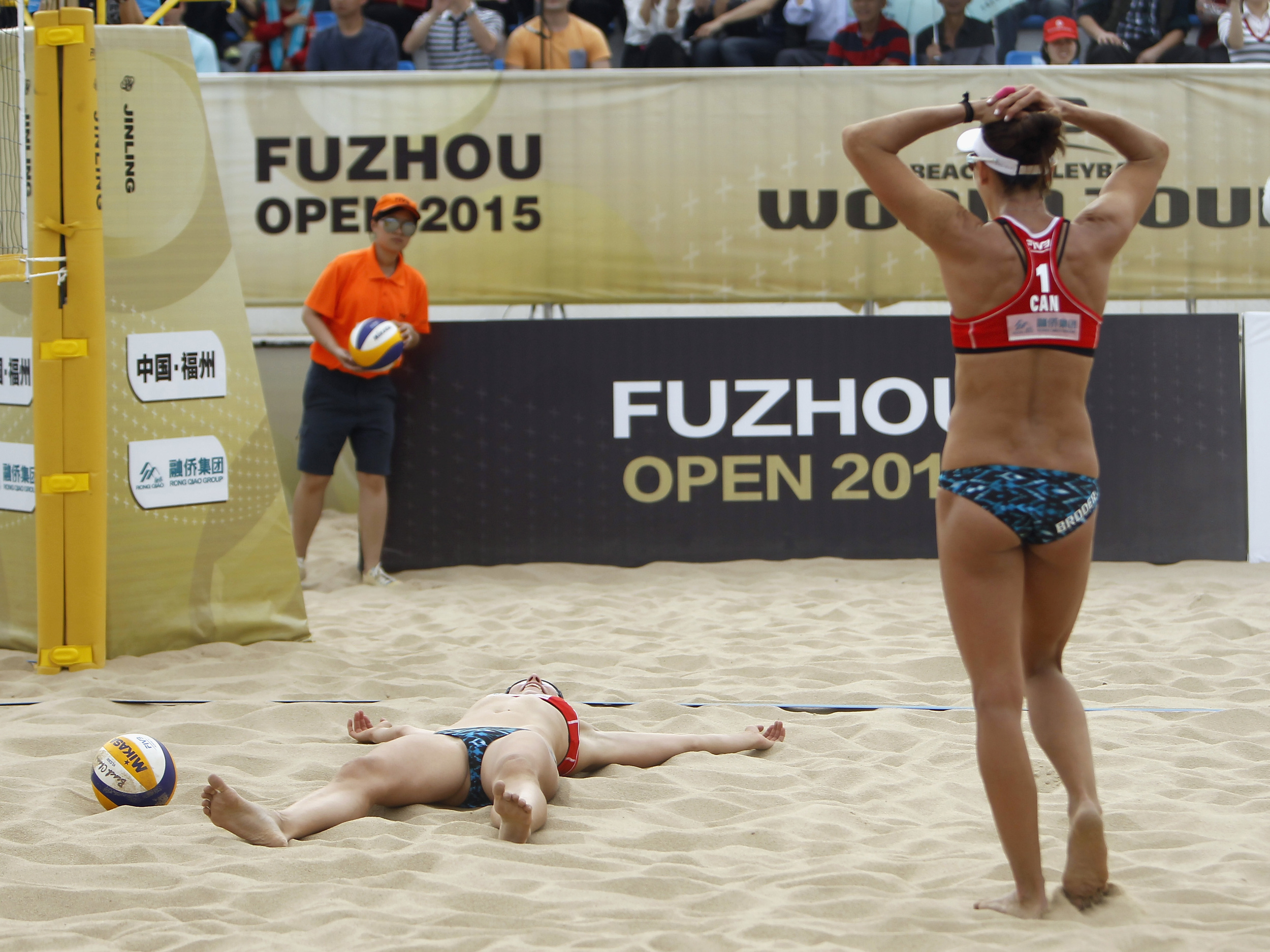 Kristina Valjas and Jamie Broder celebrate their first FIVB medal - a gold in Fuzhou  Photo: FIVB