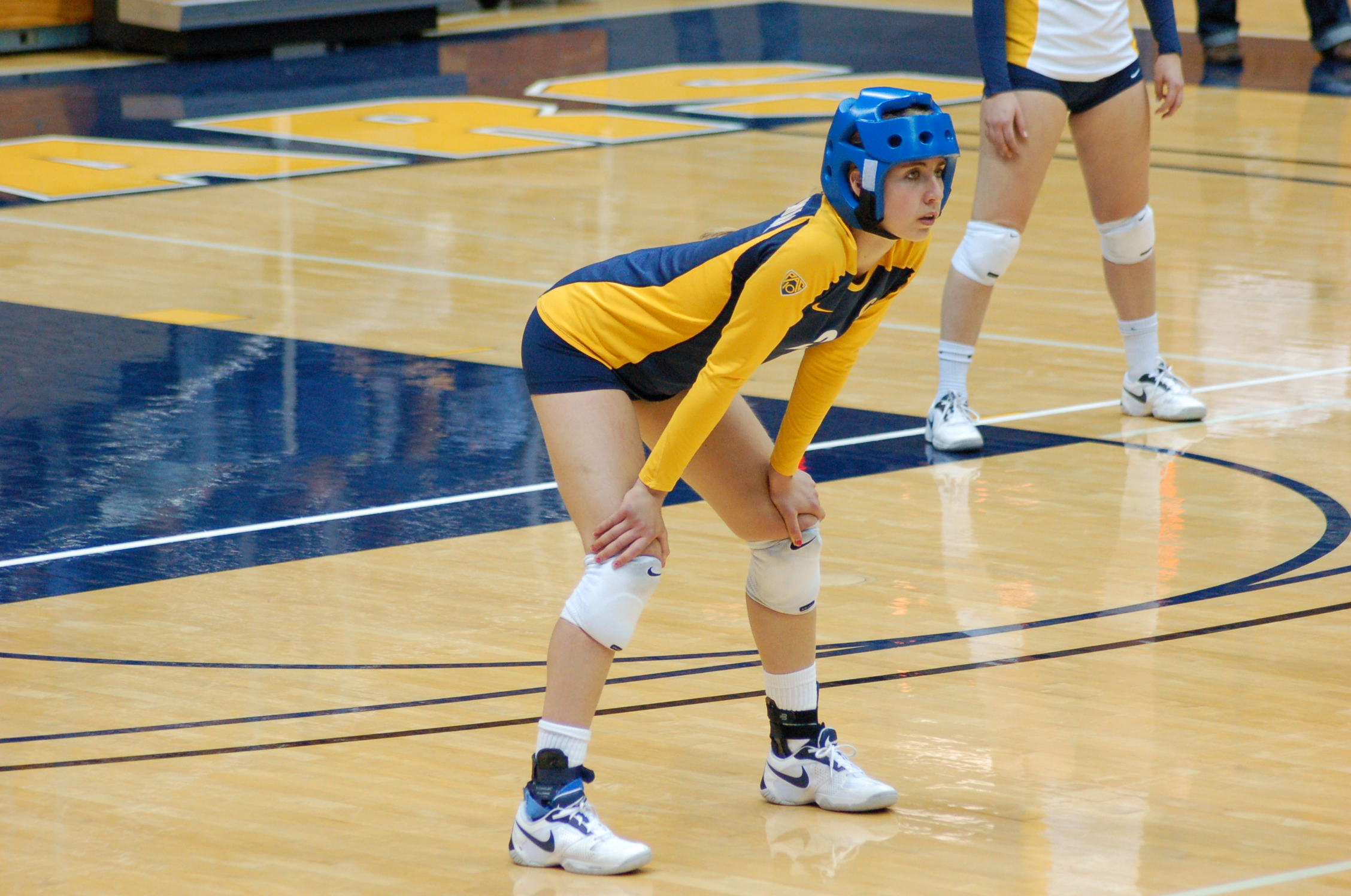 Cal Libero Robin Rostratter wearing a helmet during the 2010 NCAA Women's Volleyball Season.  Photo:  Ron Hall