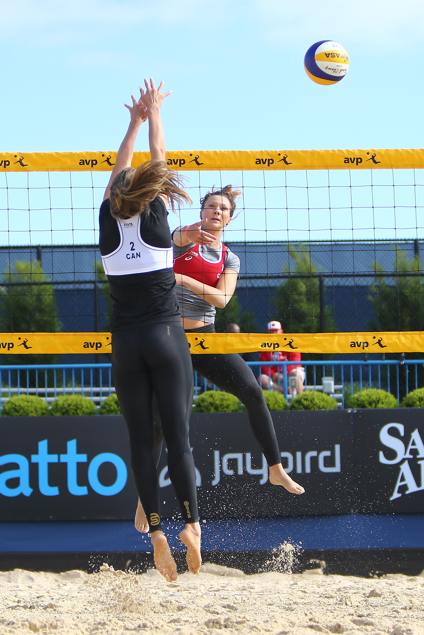 Julie Gordon hits around Taylor Pischke this morning. Picture: FIVB