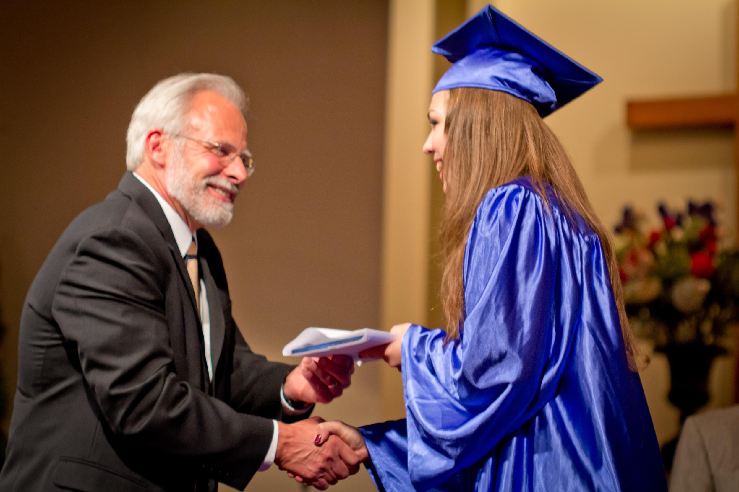 Mr Stutzman at high school graduation.
