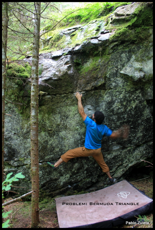 """Bermuda Triangle-V7  FA Pablo Zuleta  Morpheus  Pictured: Pablo Zuleta  Begin with big foot holds and two large underclings and move up thru the Bermuda Triangle Hold to a reachy crimp. Continue left to a jug and top it out. The Bermuda Triangle also known as the """"Devil's Triangle"""" is a cryptic, mysterious line that is difficult to explain or grasp yet with careful navigation, balance, and power it can be conquered.  Photo By. Pablo Zuleta"""