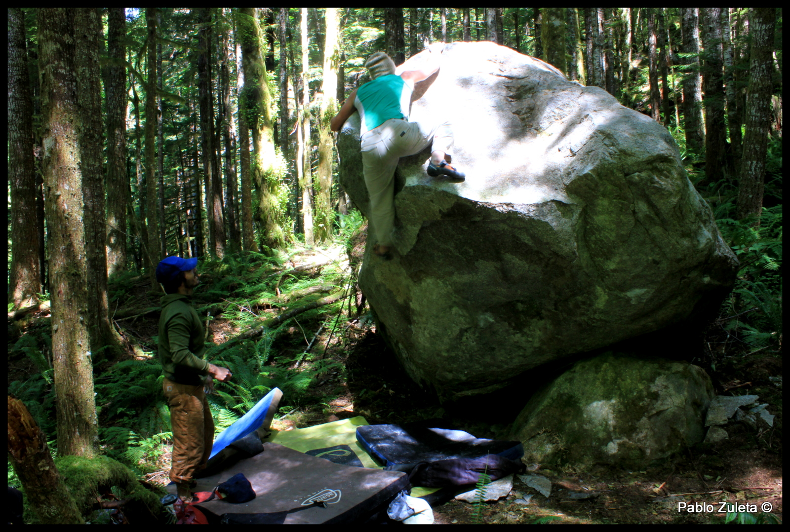 """Cole Allen climbing a boulder along the road to GoldMyer. This problem was put up by Ben Harrington and called """"scrotie mcboogerball."""""""