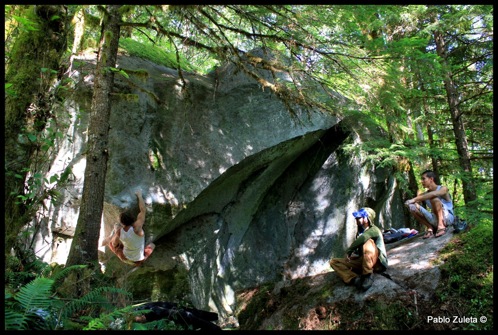 Miles Berkey climbing a new boulder Ben Shrope located.