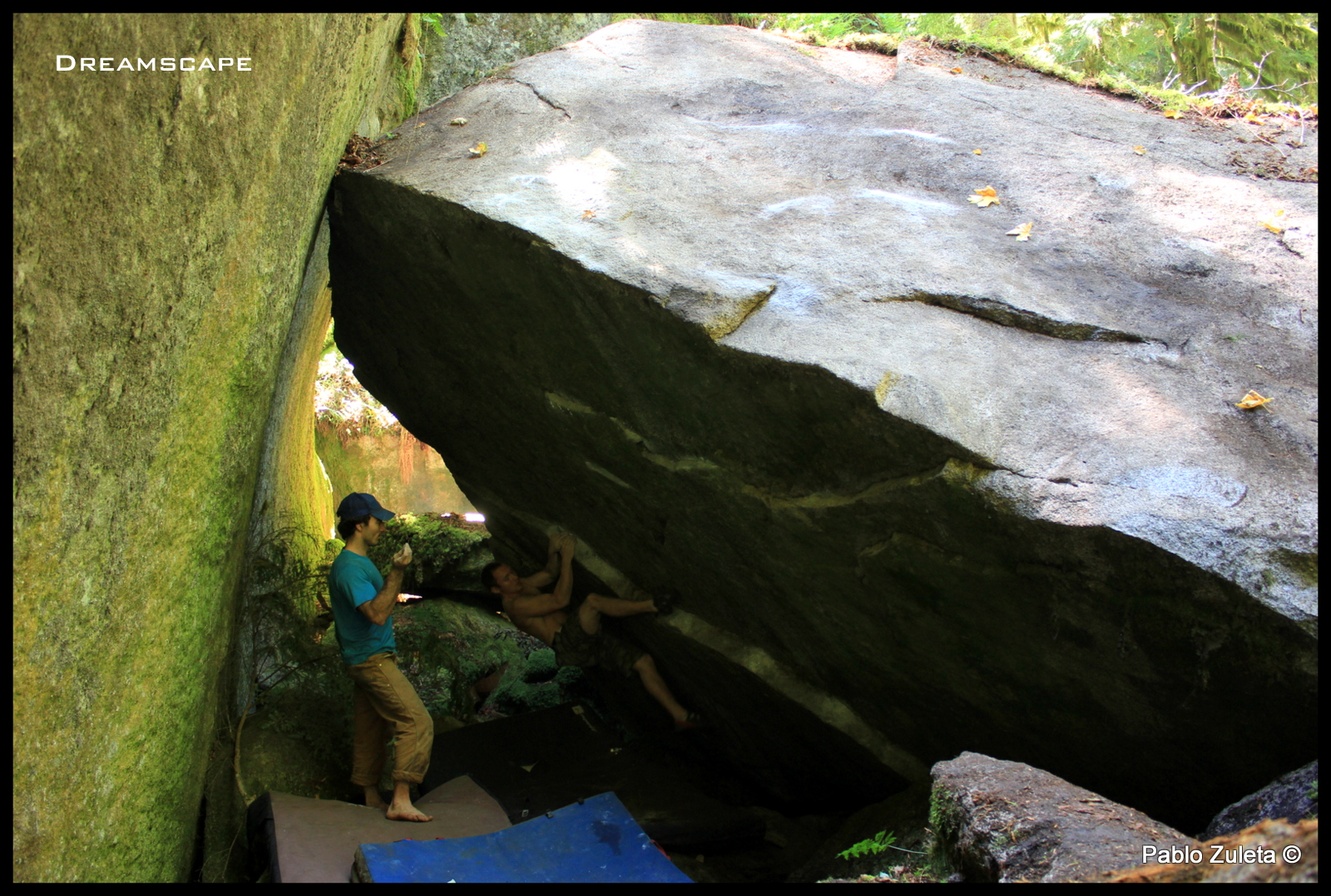 Jesse Evans getting the first ascent of Dreamscape-V9, with Pablo Zuleta on spot.
