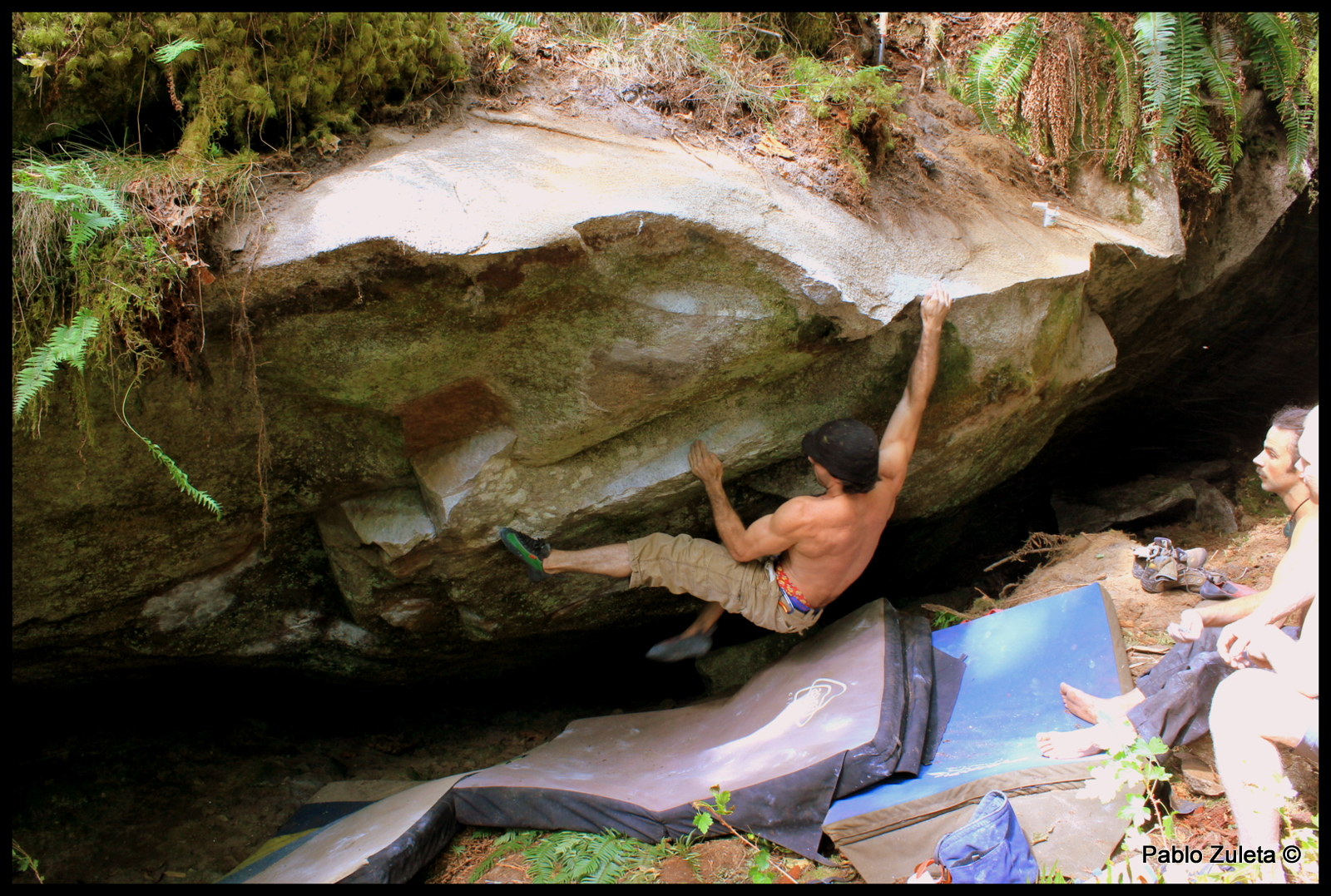 Pablo Zuleta sticking the crux after getting good foot beta from Ben and Kerwin.
