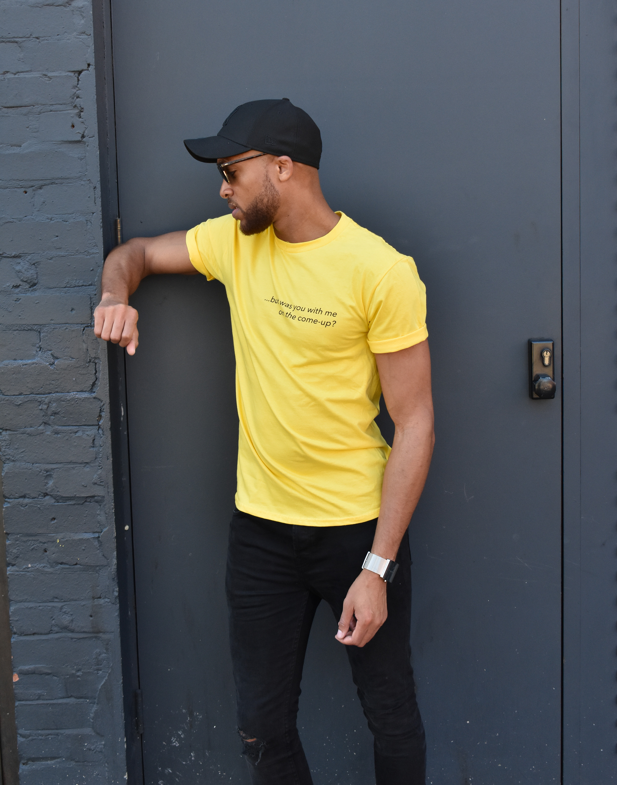 Nathan Ashley wears #OffCentre yellow - a part of our new collection. Photographed in Shoreditch.