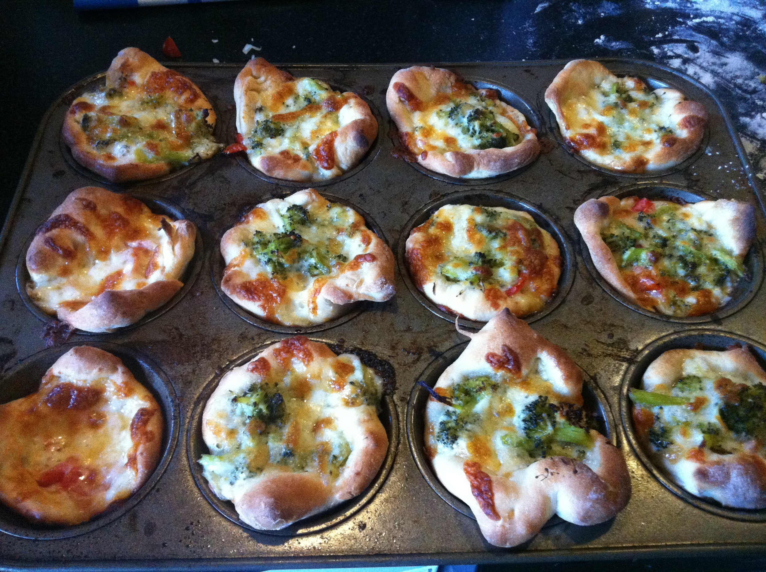 Pizzas made as if they were awesome little muffins. How freakin' cute are they?!