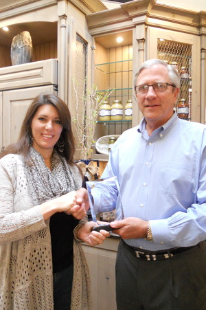 Sandy Winslow (right) presenting Tara Hutchens (left) the Second Place Award for Signature Kitchens & Baths