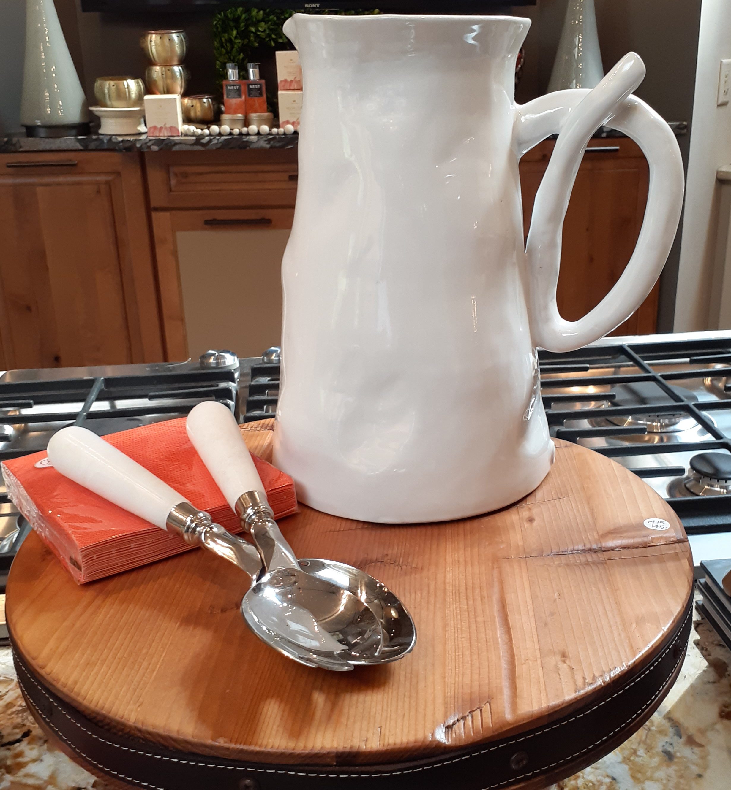 Curled Handle Pitcher $175