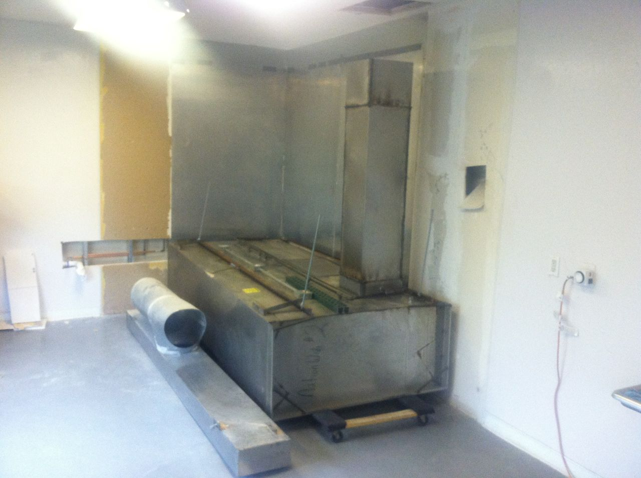 The exhaust hood provided by our landlord about to go up...