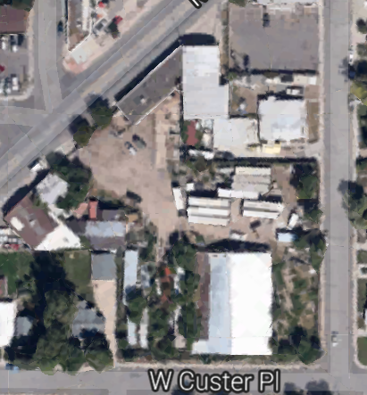This is the property when we bought it - partially collapsed warehouse, overgrown with weed trees, dilapidated mobile home and semi trailers, and countless piles of trash and debris.