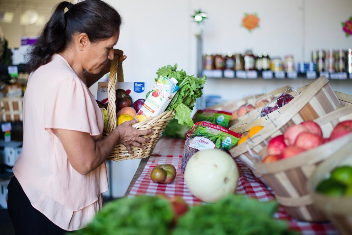 A Westwood Food Co-Op Member picking up groceries