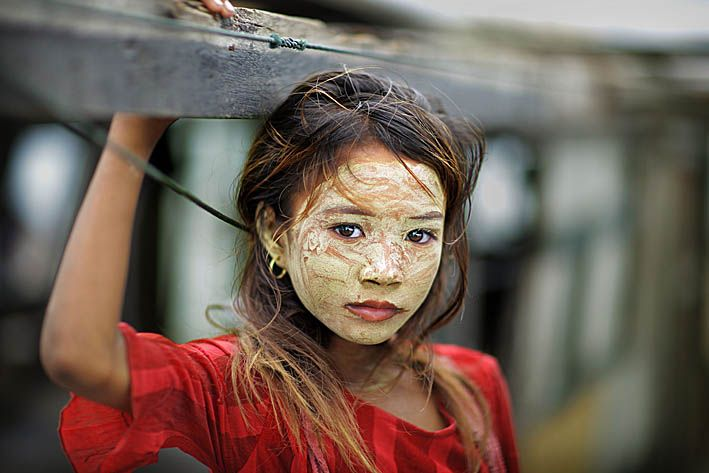 Bajau girl, with rice flour paste to protect her from the sun. Image by Timothy Allen, via Pinterest.