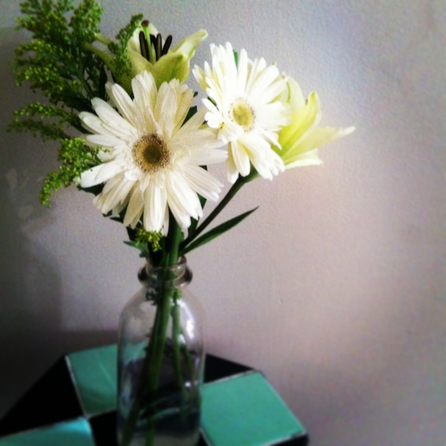 Bought myself some flowers for my room. Using milk jug from a farm in NY as vase from now on.