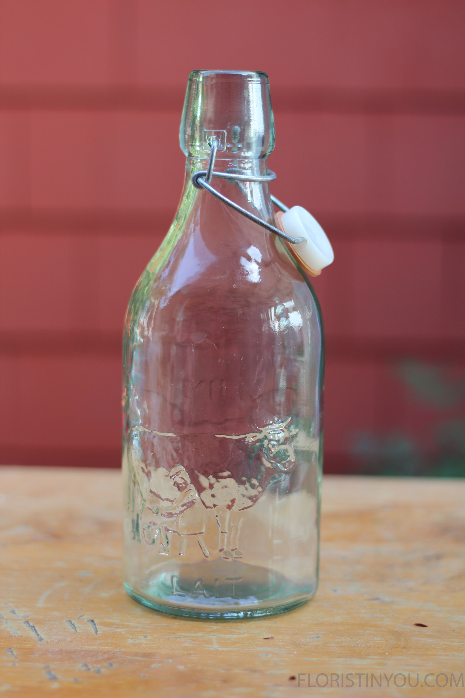 """Use a milkbottle. This oneis made of recycled glass, with """"lait"""" embossed in it. That'sFrench, for milk."""