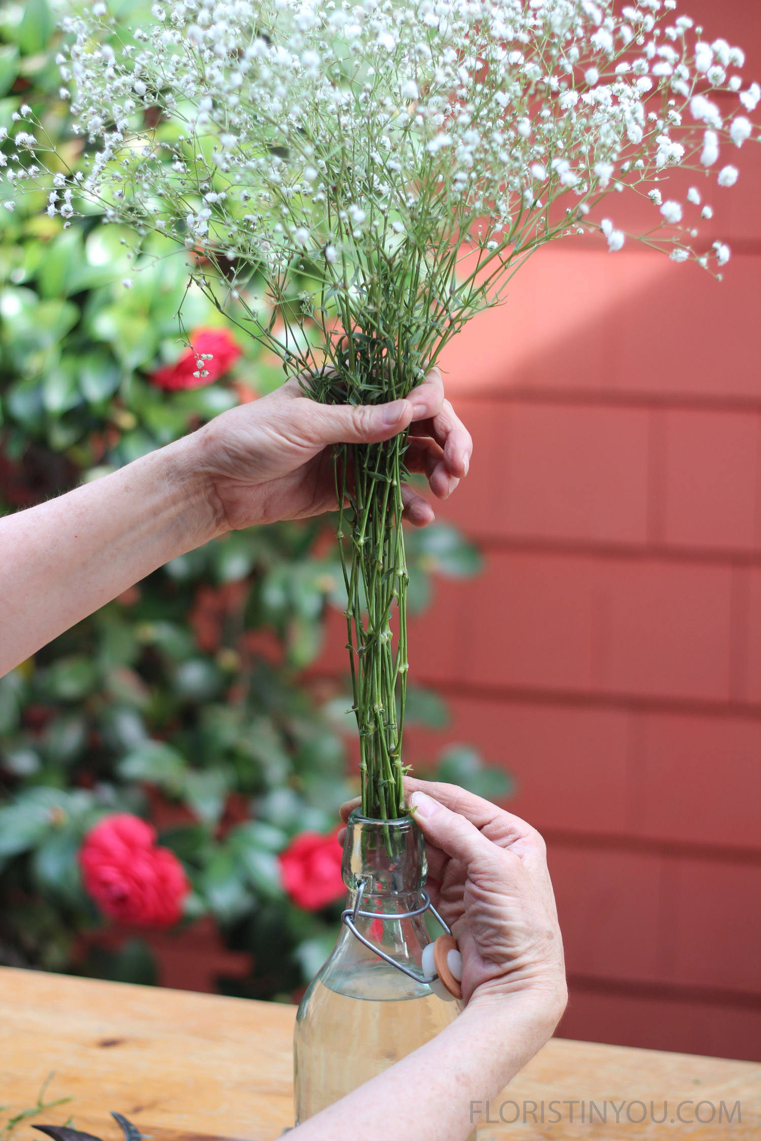 Hold stems together and guide through neck of bottle.