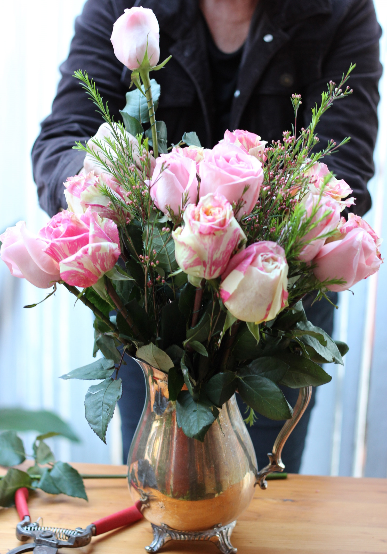 Next,add the all pink roses to create a full bouquet.