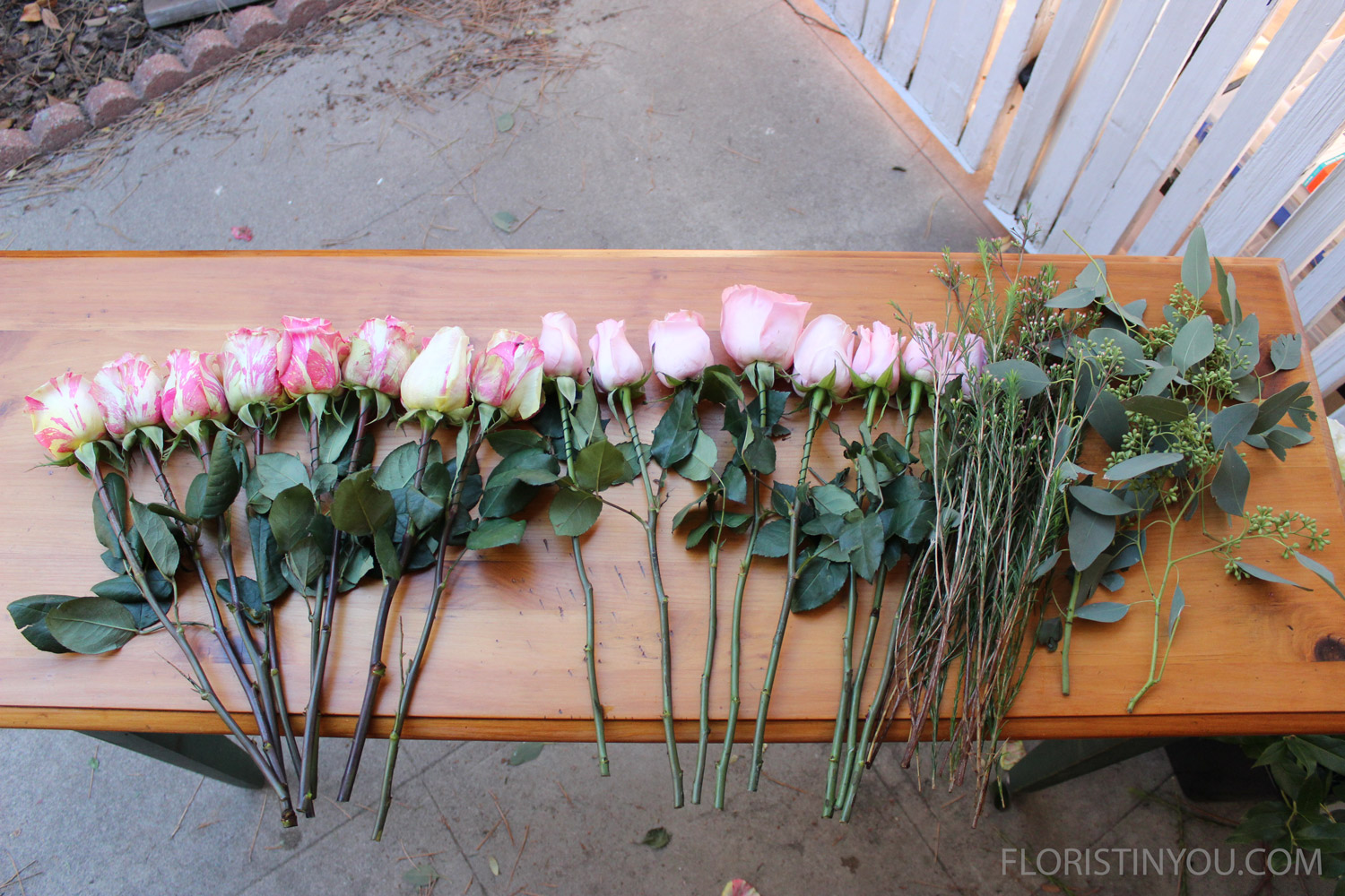 You will use 8 candy cane roses, 8 pink roses, 10 pink wax flower stems with buds, and seeded eucalyptus.